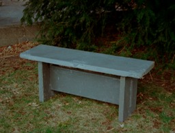 Bluestone bench with hand carving