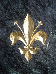 Carved fleur de lis with gold leaf
