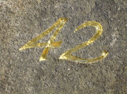 Carved number with glod leaf