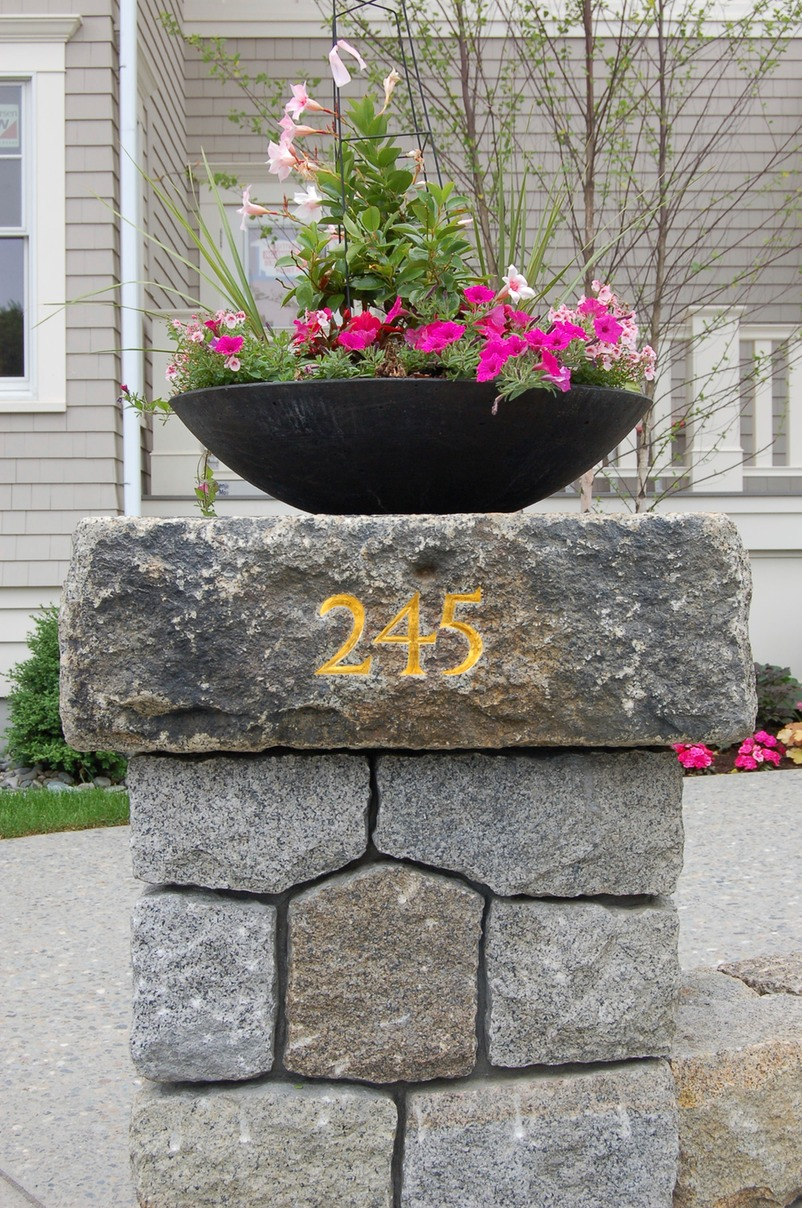 Hand carved number on granite column
