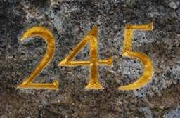 hand carved numbers on granite