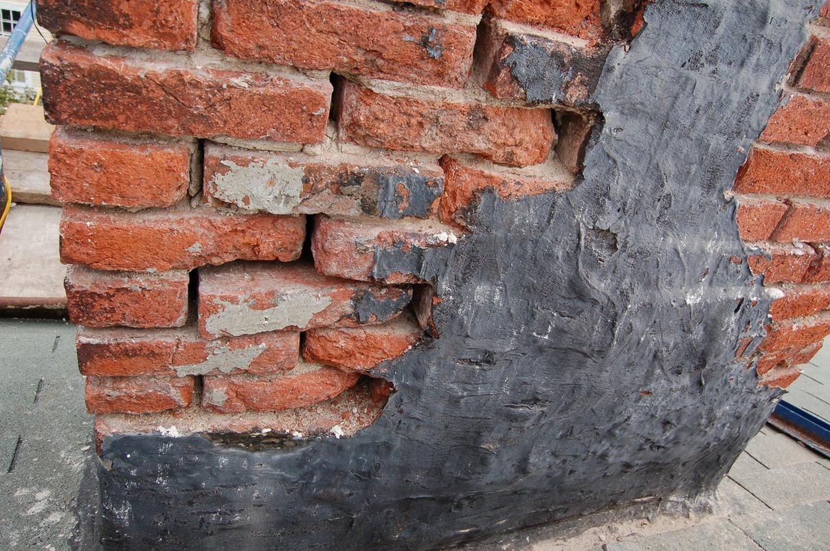 Brick damaged by tar repairs