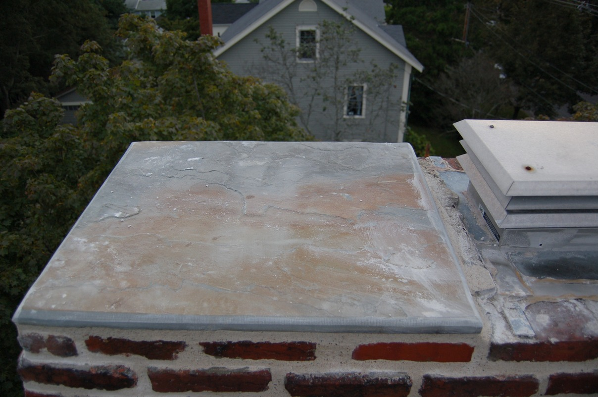Unused chimney flues capped with bluestone