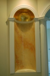 Venetian plaster stone reproduction niche with 24kt. gilded dome